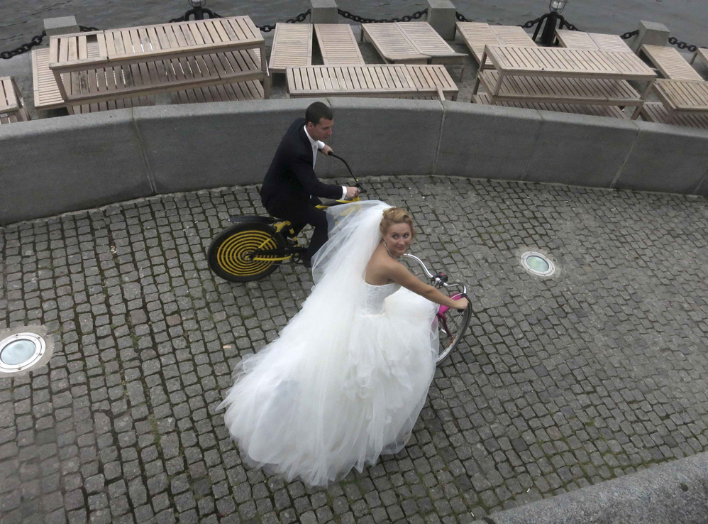 Yelena Babkini and her husband Boris ride through Gorky Park on bicycles after having been married earlier in the day in Moscow