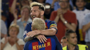 Barcelona's Argentinian forward Lionel Messi (up) celebrates a goal with teammate Barcelona's Brazilian forward Neymar during the UEFA Champions League football match FC Barcelona vs Celtic FC at the Camp Nou stadium in Barcelona on September 13, 2016. / AFP PHOTO / JOSEP LAGO